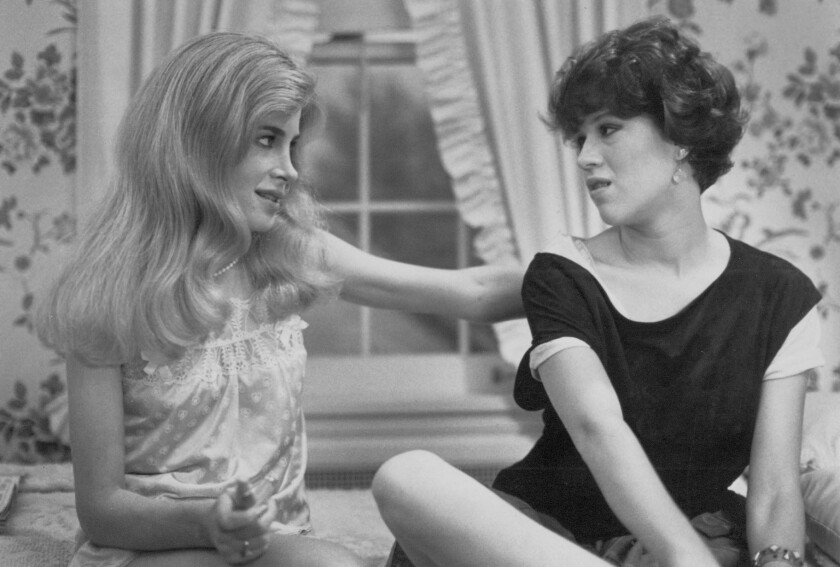 """Writer-director John Hughes' iconic 1980s coming-of-age films, like 1984's """"Sixteen Candles"""" starring Blanche Baker and Molly Ringwald, were beloved by young audiences and influenced later generations of filmmakers."""