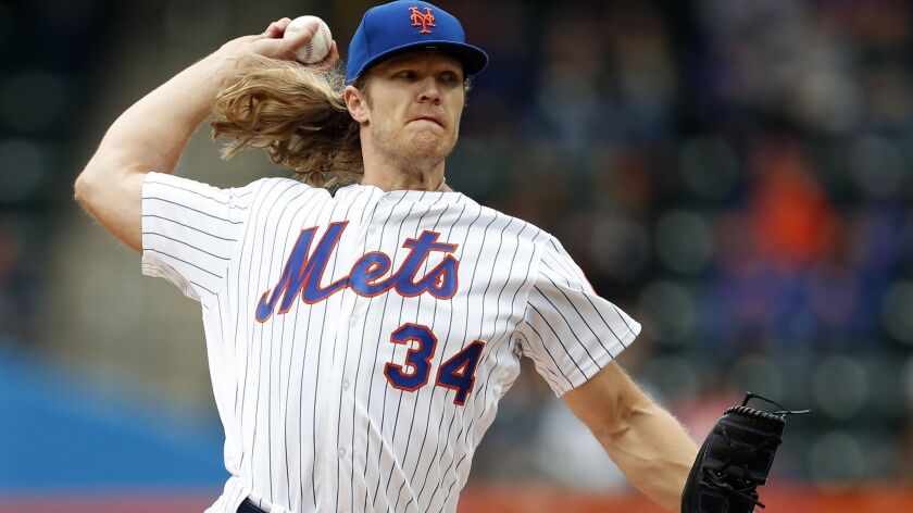 New York Mets starting pitcher Noah Syndergaard delivers during the first inning of a baseball game