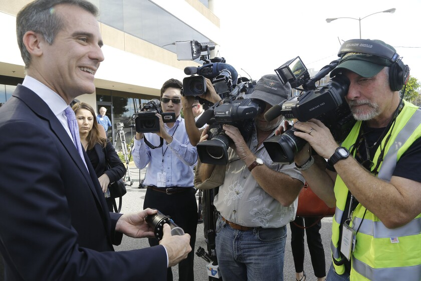 Los Angeles Mayor Eric Garcetti, holds a model joint of an earthquake-resistant ductile iron pipe during a Jan. 16 media event in Northridge.