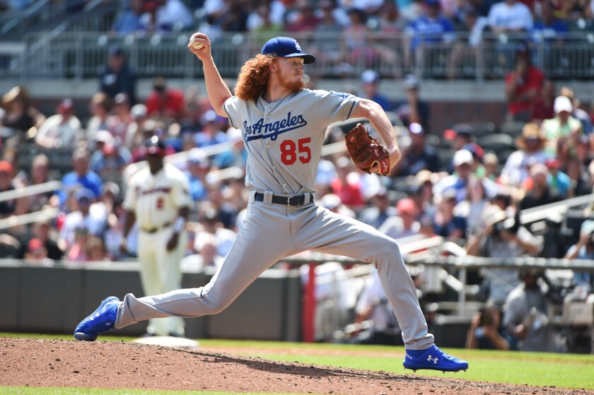 Dodgers pitcher Dustin May delivers during a 5-3 loss to the Atlanta Braves on Sunday.