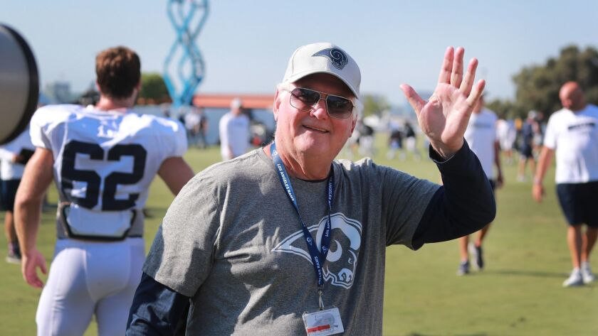 IRVINE, CALIF. -- MONDAY, AUGUST 13, 2018: Rams defensive coordinator Wade Phillips waves at fans a