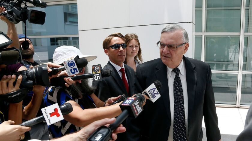 Former Maricopa County Sheriff Joe Arpaio, right, leaves U.S. District Court on the first day of his