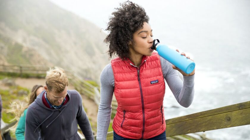 Woman sips from 21 ounce Hydro Flask Standard Mouth bottle with Sport Cap. Credit: Hydro Flask