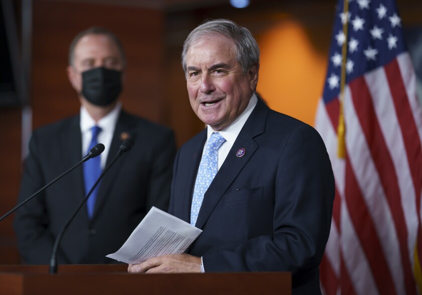 FILE - In this Sept. 21, 2021, file photo House Budget Committee Chair John Yarmuth, D-Ky., joined at left by House Intelligence Committee Chairman Adam Schiff, D-Calif., talks to reporters at the Capitol in Washington. Yarmuth, who as chairman of the House Budget Committee has played a key role in pushing for President Joe Biden's efforts to expand the nation's social safety net, announced Tuesday, Oct. 12, that he will not seek another term next year.(AP Photo/J. Scott Applewhite, File)