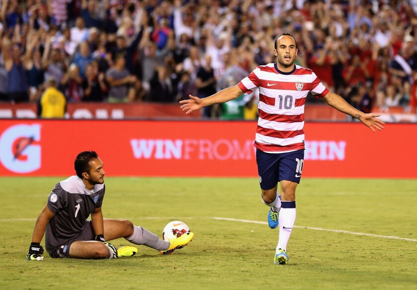 Landon Donovan, right, celebrates after scoring past Guatemala goalkeeper Ricardo Jerez on a penalty kick during the U.S. national team's 6-0 victory Friday.