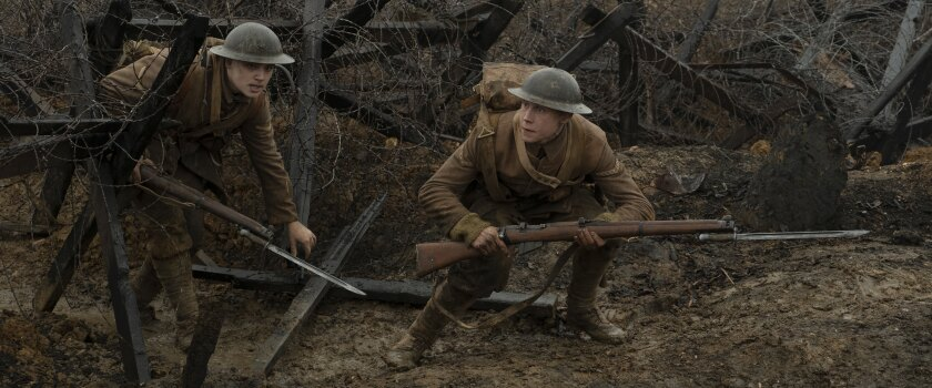 """A scene from """"1917"""" with Dean-Charles Chapman and George MacKay"""