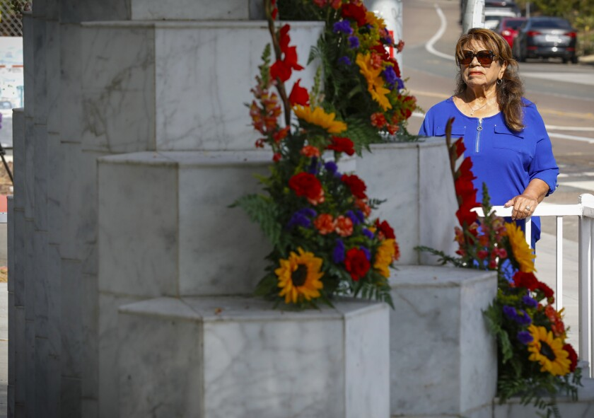 Gloria Salas at a memorial for the 21 lives lost to a mass shooting in San Ysidro in 1984.