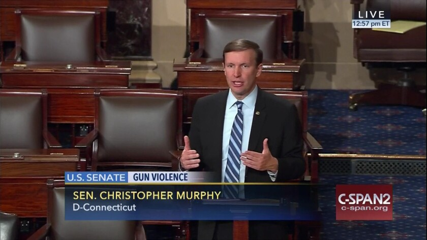 Sen. Chris Murphy (D-Conn.) on the floor of the Senate. He launched a filibuster demanding a vote on gun control measures.