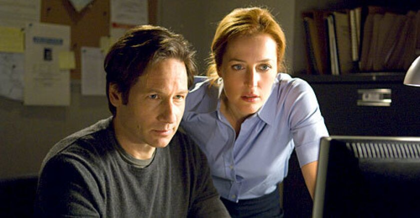 'X-FILES' REOPENED: Anderson played Dana Scully and Duchovny was Fox Mulder. The movie is due out in July