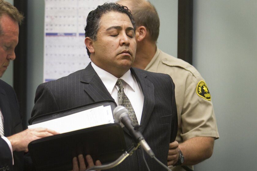 SDPD traffic Officer Anthony Arevalos is led away in handcuffs after his arraignment in March 2011.