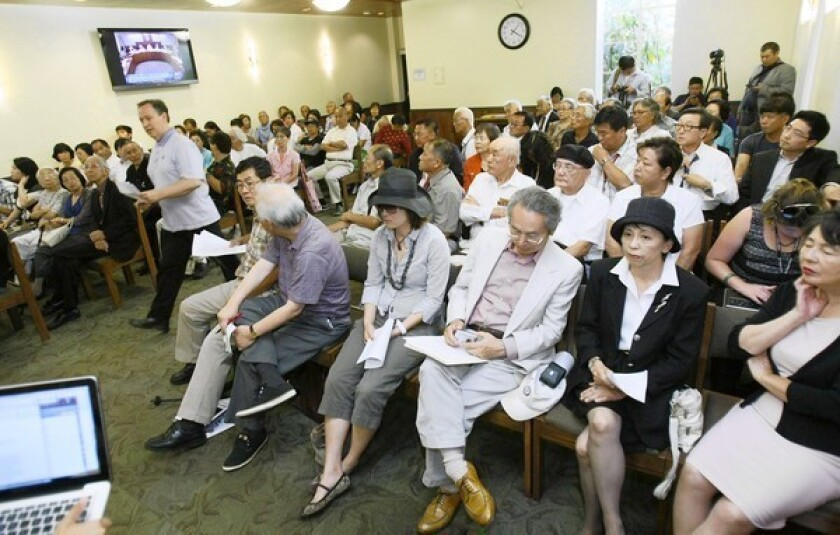 """At a Glendale City Council meeting, a member of the public walks up to speak on the topic of a """"comfort woman"""" statue destined for Central Park."""