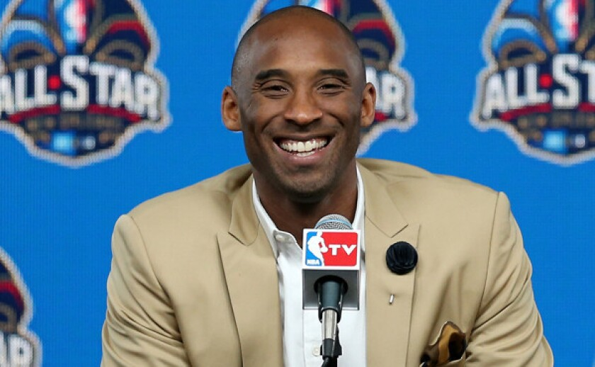 Lakers star Kobe Bryant smiles while answering questions during a news conference before Sunday's NBA All-Star Game in New Orleans. Bryant says he's optimistic about the Lakers once again becoming one of the league's elite teams.