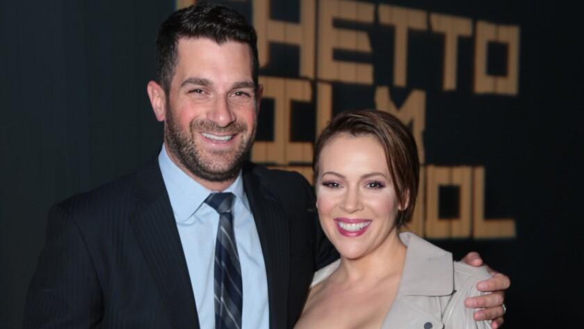 Dave Bugliari and Alyssa Milano attend the Ghetto Film School benefit.