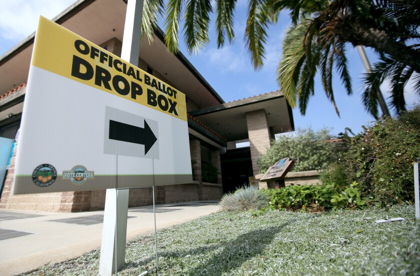 A sign points to an official ballot box at the Mesa Water District in Costa Mesa.