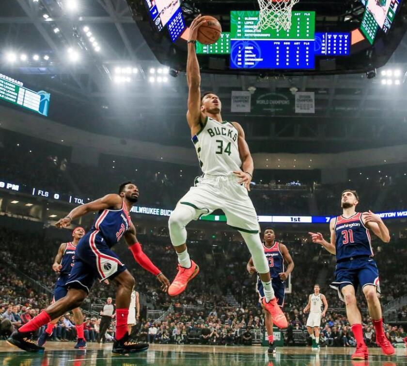 Milwaukee Bucks forward Giannis Antetokounmpo of Greece (C) shoots between Washington Wizards guard Tomas Satoransky of the Czech Republic (R) and Washington Wizards forward Jeff Green (L) during their NBA game at Fiserv Forum in Milwaukee, Wisconsin, USA, Feb. 6, 2019. EPA-EFE/TANNEN MAURY SHUTTERSTOCK OUT