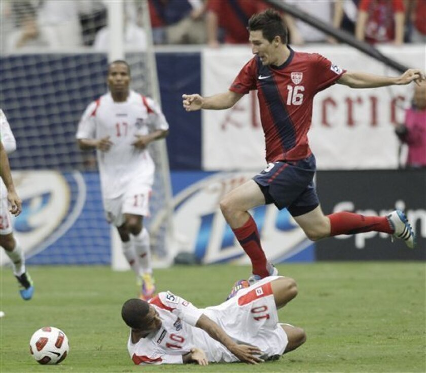 Panama's Nelson Barahona hits the turf as he and the United States' Sacha Kljestan compete for the ball during the first half of a CONCACAF Gold Cup semifinal soccer match Wednesday, June 22, 2011, in Houston. (AP Photo/David J. Phillip)