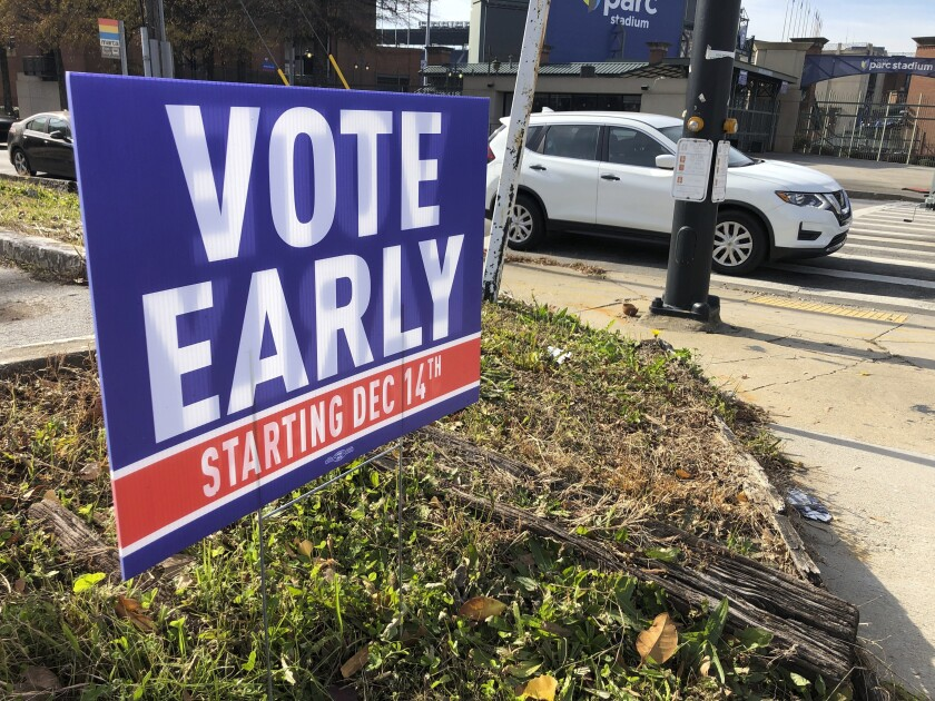 A sign in an Atlanta yard urges neighbors to vote early.