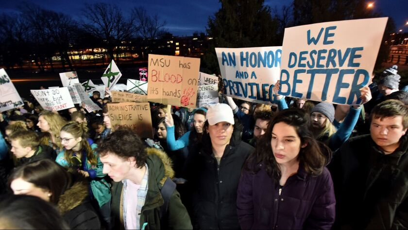 Demonstrators gather at Michigan State University's East Lansing, Mich., campus to support victims of disgraced former sports doctor Larry Nassar and call for more changes in leadership at the school.