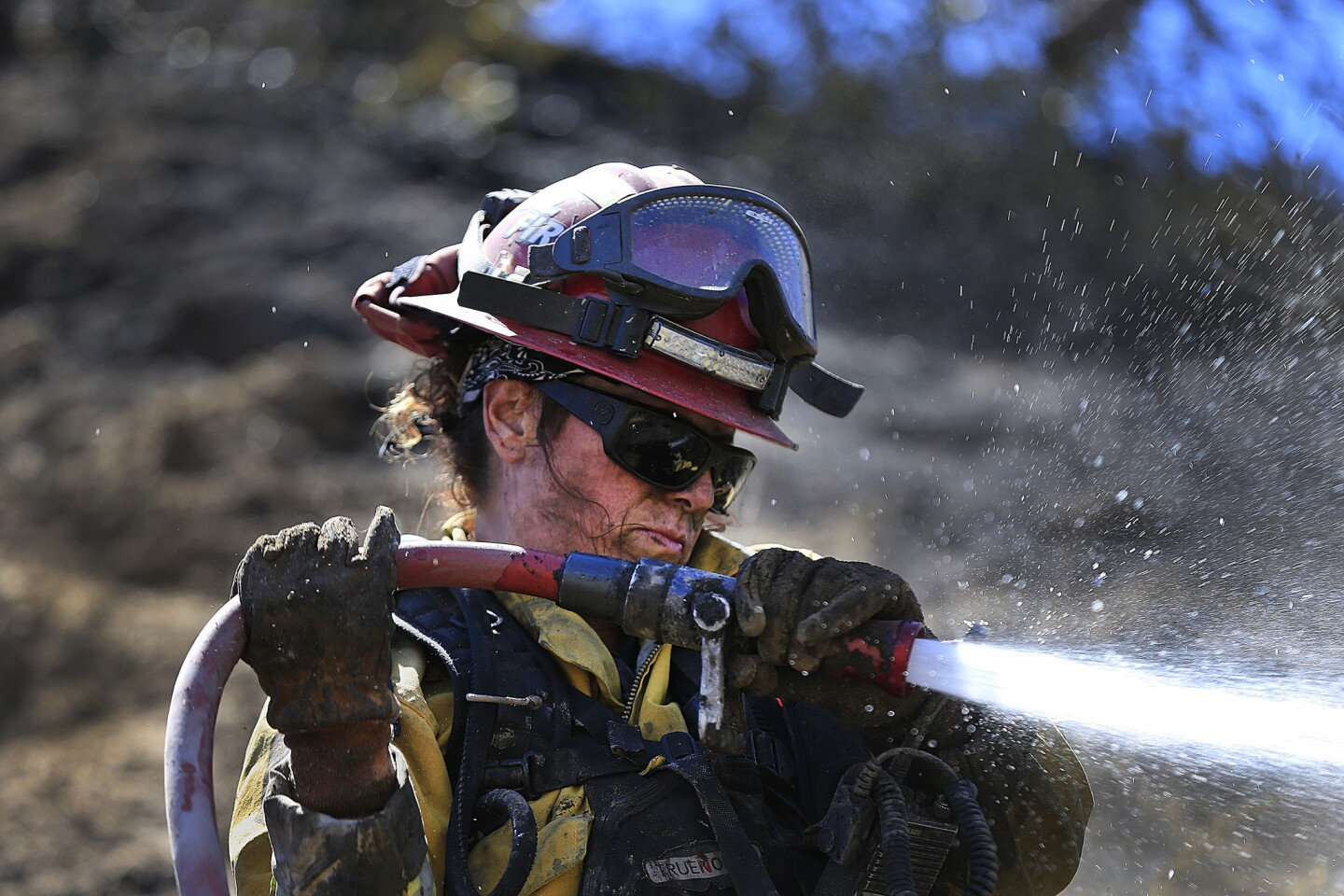 Cal Fire-San Diego firefighter Capt. Angel Hendrieat the Sage fireon Sunday.