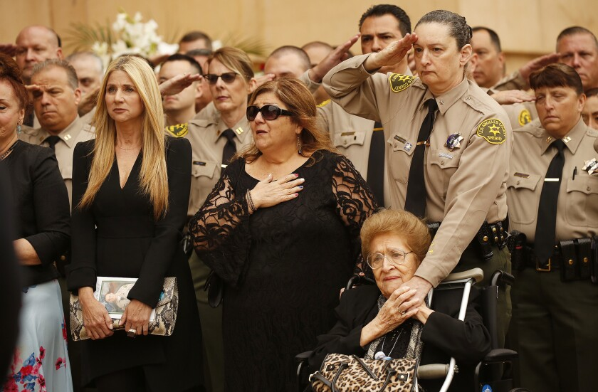 LOS ANGELES, CA - JUNE 24, 2019 - Family including Deputy Solano's GodMother Sallome Yanez, right, a