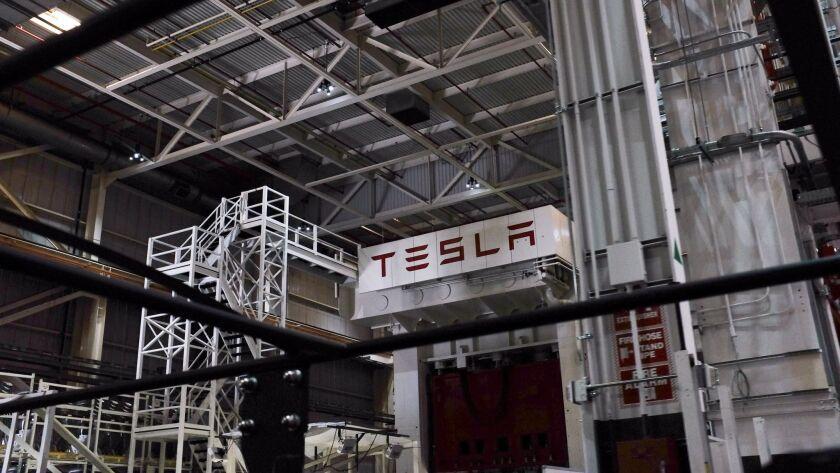 A metal stamping press at Tesla's Fremont plant.