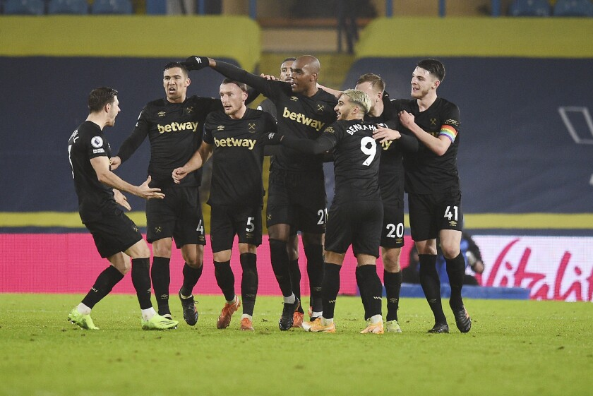 West Ham's Angelo Ogbonna celebrates with his teammates after scoring his side's second goal during the English Premier League soccer match between Leeds United and West Ham at Elland Road stadium in Leeds, England, Friday, Dec. 11, 2020. (Oli Scarff, Pool via AP)