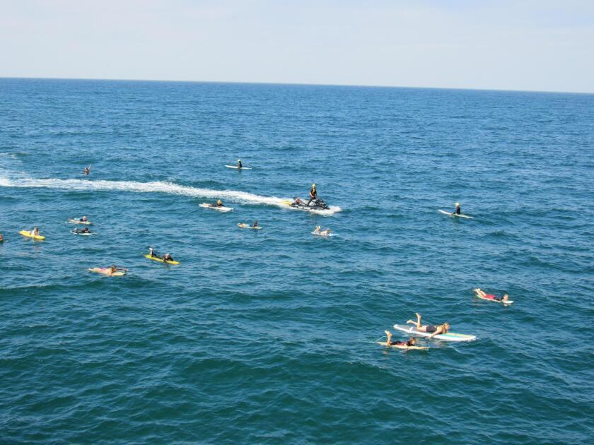 Lifeguard on jetskis surveys the waters