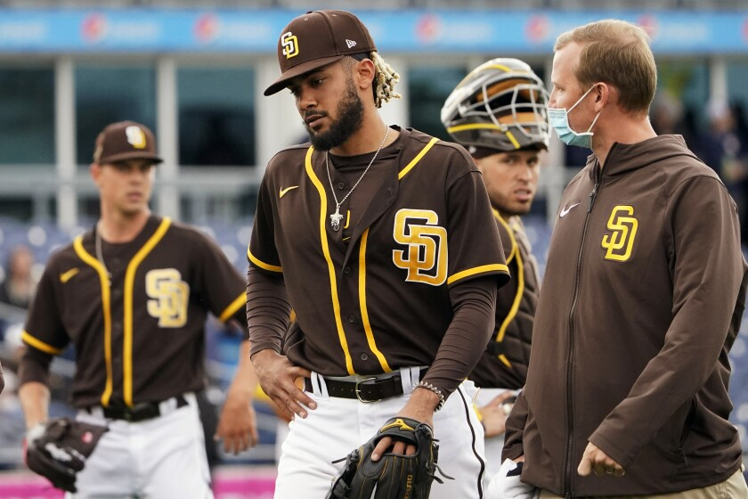 Fernando Tatis Jr. leaves field in third inning Tuesday after injuring his left shoulder.