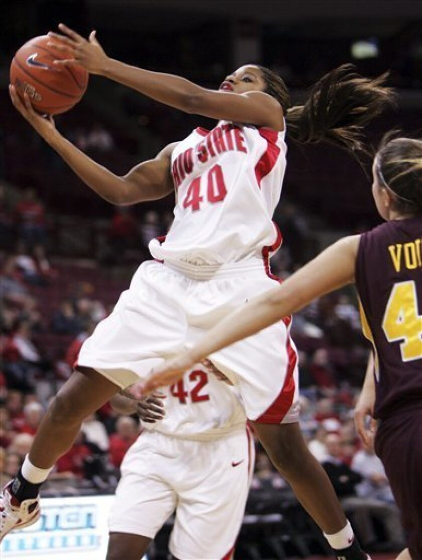 Ohio State's Brittany Johnson, left, goes up for a shot over Minnesota's Jackie Voigt during the first half of an NCAA college women's basketball game at Ohio State University in Columbus, Ohio, Thursday, Jan. 15, 2009. (AP Photo/Paul Vernon)