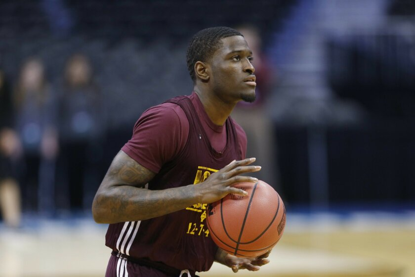 Iona guard A.J. English looks to shoot the ball during practice for a first-round men's college basketball game in the NCAA Tournament, Wednesday, March 16, 2016, in the NCAA Tournament in Denver. Iona takes on Iowa State on Thursday.  (AP Photo/David Zalubowski)