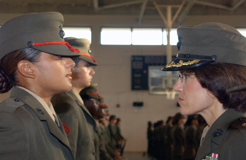 Then-Lt. Col. Cynthia Valentin, commanding officer of the Fourth Recruit Training Battalion, inspects a row of recruits in 2005 at Parris Island, S.C. Valentin now speaks out against harassment of female Marines.