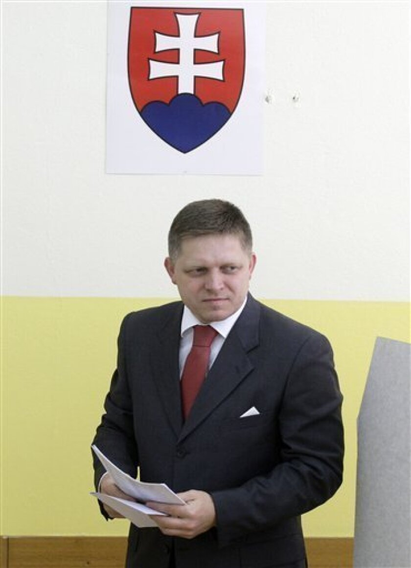 Slovakia's Prime Minister and chairman of Social Democratic party Smer  Robert Fico, prepares to cast his ballot, during the general elections in Bratislava, Slovakia, Saturday, June 12, 2010. (AP Photo/Petr David Josek)
