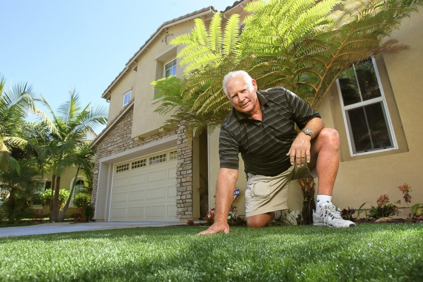 Carlsbad resident Rocky Wilson on his artificial front lawn in front of his home.