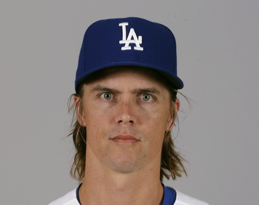FILE - This is a 2015 file photo showing Zack Greinke of the Los Angeles Dodgers baseball team. Greinke has opted out of the final three years of his contract with the Dodgers, giving up a guaranteed $71 million to become a free agent again. Greinke was among 12 additional players who became free a