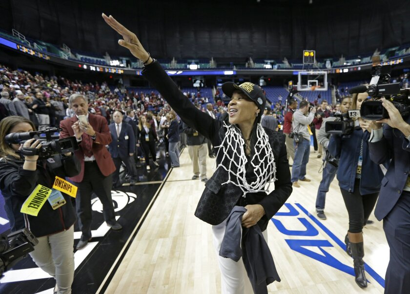 South Carolina head coach Dawn Staley waves to fans after a women's college basketball regional final game against Florida State in the NCAA Tournament in Greensboro, N.C., Sunday, March 29, 2015. South Carolina won 80-74. (AP Photo/Chuck Burton)