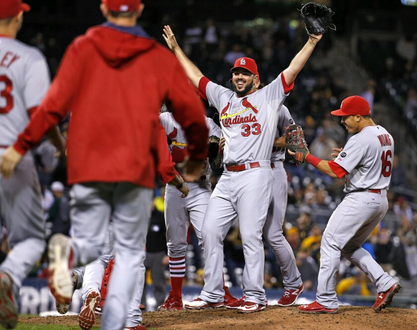Cardinals relief pitcher Carlos Villanueva (33) celebrates getting the final out of an 11-1 win over the Pittsburgh Pirates in a baseball game in Pittsburgh, Wednesday, Sept. 30, 2015. With the win the Cardinals clinched the Central Division.