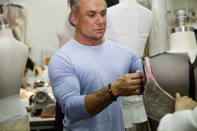 Designer Mark Zunino tends to one of his dresses in a workroom of his Beverly Hills showroom. His clients include Julia Roberts, Angelina Jolie, Jennifer Lopez and Beyonce.