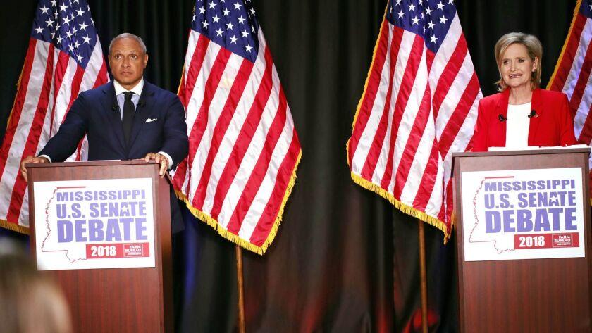 Democrat Mike Espy and Sen. Cindy Hyde-Smith (R-Miss.) during their debate on Nov. 20.