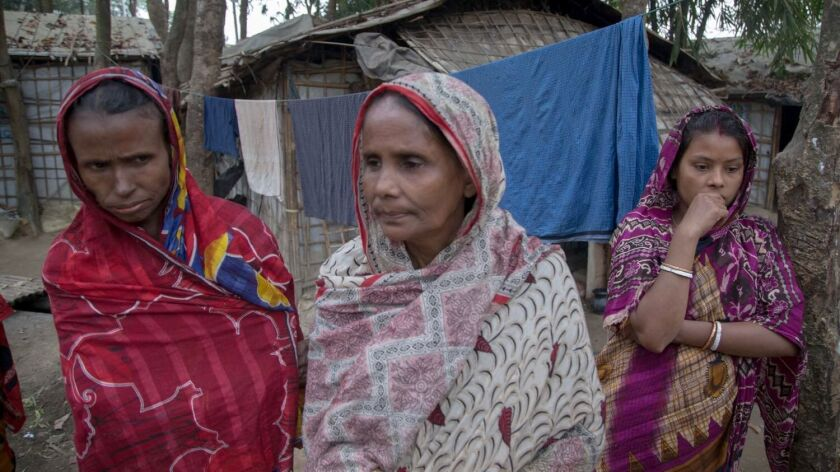 Jushna Pal, center, and her neighbors in the Hindu Camp in southern Bangladesh where more than 700,0