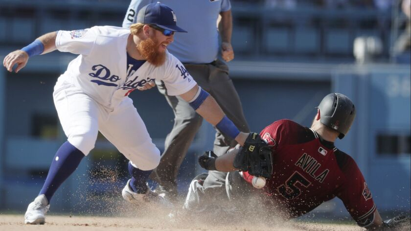 LOS ANGELES, CA, SUNDAY, SEPTEMBER 2, 2018 - Dodgers infielder Justin Turner drops the ball as he tr