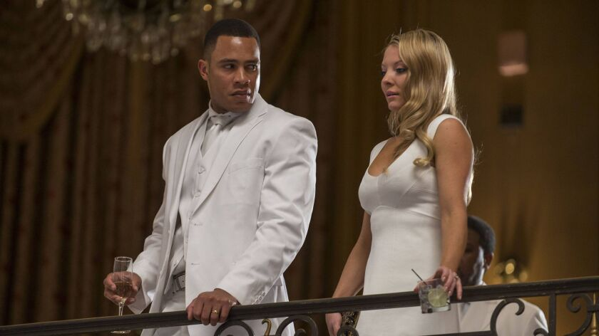 EMPIRE: Andre (Trai Byers, L) and his waife Rhonda (Kaitlin Doubleday, R) attend the all white party