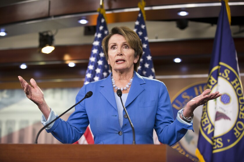 House Minority Leader Nancy Pelosi (D-San Francisco), pictured at a Washington news conference this month, is supporting an anti-deportation bill in Sacramento along with 27 other California Democrats in Congress.