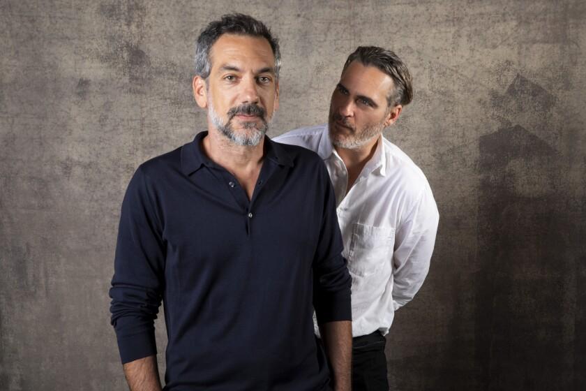 """""""Joker"""" director Todd Phillips, left, and star Joaquin Phoenix."""