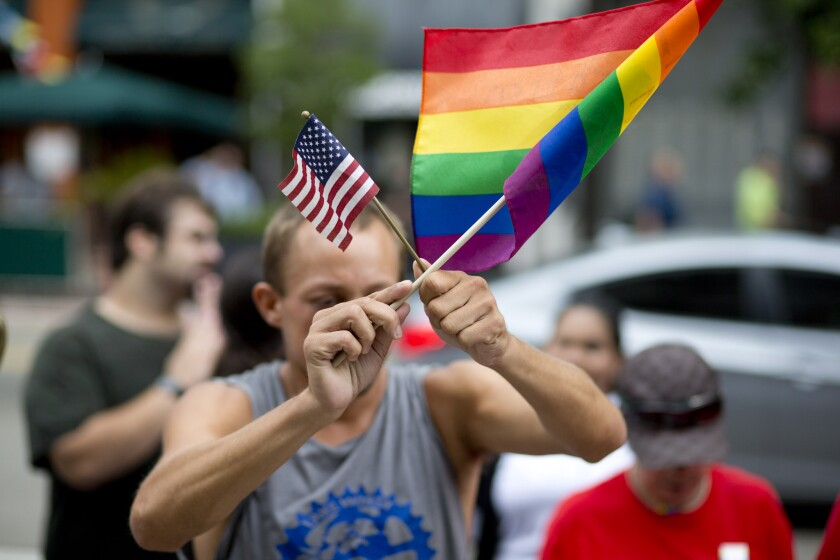 A man demonstrates outside a Miami courthouse July 2 during a hearing about same-sex marriage.