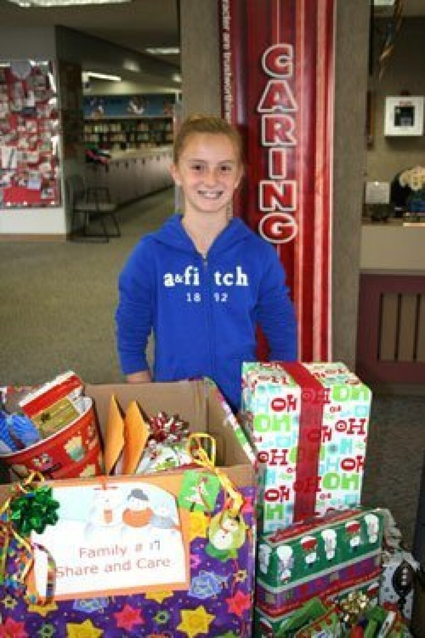 Solana Highlands fourth grader Ally Greenhalgh skipped birthday gifts this year and instead collected toy donations for Care and Share program at her school. Photo/Karen Billing