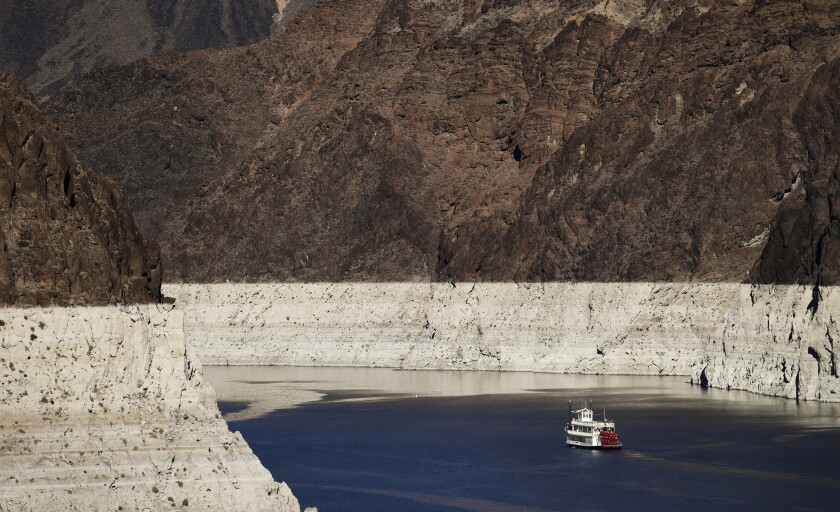 FILE - In this Oct. 14, 2015, file photo, a riverboat glides through Lake Mead on the Colorado River at Hoover Dam near Boulder City, Nev. The key reservoir on the Colorado River is expected to match its record low level on Thursday, June 10, 2021. The dropping surface elevation of Lake Mead along the Arizona-Nevada border is the another sign of the drought's grip on the region. (AP Photo/Jae C. Hong, File)