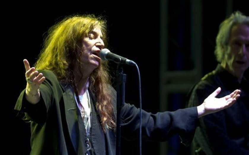 FILE - This May 5, 2012 file photo shows U.S. rock singer Patti Smith performing during her concert in Mexico City. Smith will be honored by Bryn Mawr College for her artistic accomplishments and pioneering spirit. The women's liberal arts school near Philadelphia announced that Smith will receive