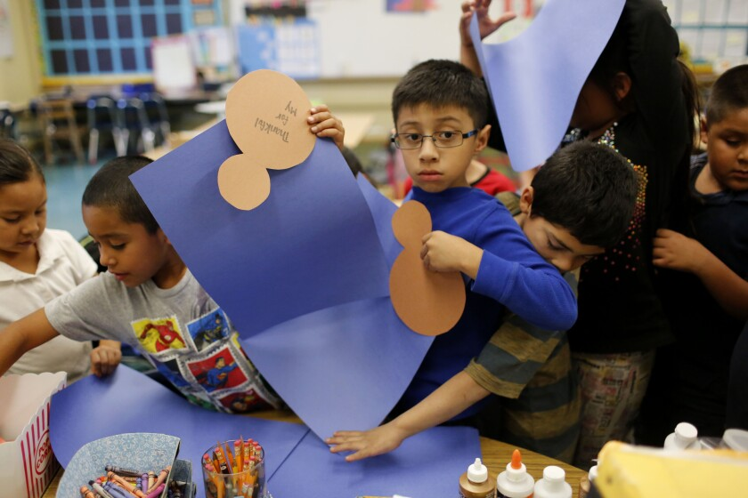 Second-graders at Ann Street Elementary School gather materials during an arts-and-crafts class, which is part of LA's Best after-school program.