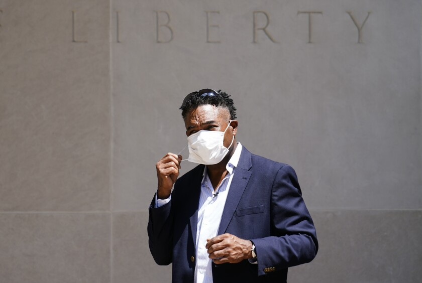 Former NFL player Ken Jenkins exits the building after delivering tens of thousands of petitions demanding equal treatment for everyone involved in the settlement of concussion claims against the NFL, to the federal courthouse in Philadelphia, Friday, May 14, 2021. (AP Photo/Matt Rourke)