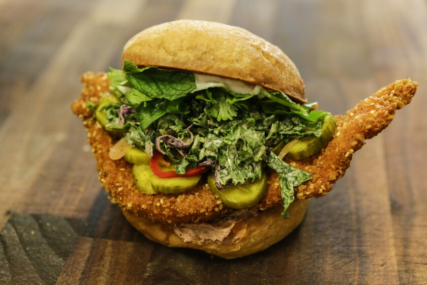 LOS ANGELES, CA -- MONDAY, OCTOBER 29, 2018-- The newly established restaurant Banh Oui, a vietnamese inspired sandwich shop opened this past July in Hollywood, Calif. The organic fried chicken sandwich offers pickles, cole slaw and peppers. (Maria Alejandra Cardona / Los Angeles Times)
